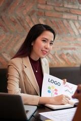 Graphic designer showing her work