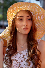 Fashion portrait of young stylish hipster woman walking on the street, wearing trendy outfit, straw hat, travel.