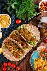 Fresh felafel balls served in pitas with hummus and vegetables