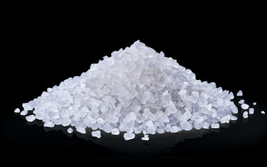 heap of salt isolated on black background. Wall mural