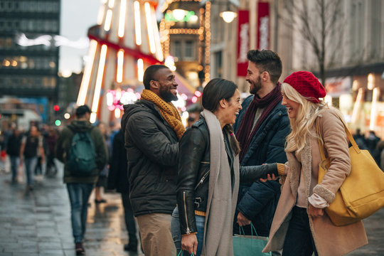 Two Couples Meeting on a City Street