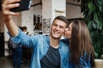 Couple Taking Photos With Coffee In Cafe