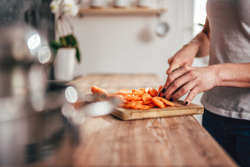 Woman cutting carrot