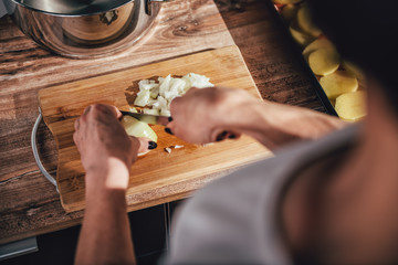 Woman cutting onion