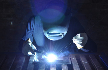 welder welds the metal tungsten inert gas