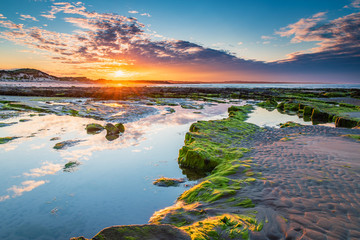 Sunset over Low Hauxley Rockpool / Low Hauxley Beach on the Northumberland coastline consists of both sandy areas and rocky outcrops