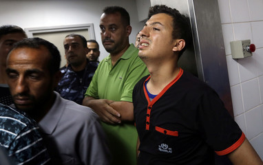 Relative of a Palestinian Hamas member, who was killed in an Israeli air strike, reacts at a hospital in the southern Gaza Strip