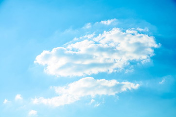 A graphical resource consisting of a cloudy sky on a sunny day.
