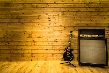 Electric guitar in music studio, copy space template background