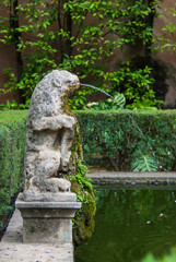 Seville, Spain - June 2018: The fountain in the park of the Alcazar palace in Seville, Spain, Europe.
