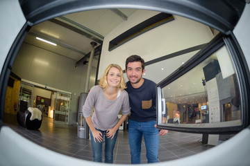 Fisheye view of couple from inside a woodburner Wall mural