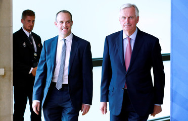 Britain's Secretary of State for Exiting the EU Raab and EU's chief Brexit negotiator Barnier arrive ahead of a meeting in Brussels