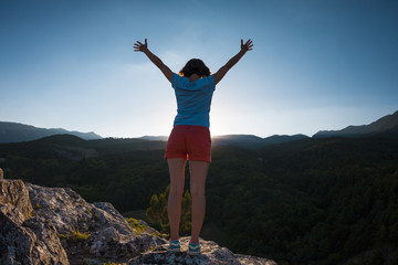 Girl at the top of the mountain.