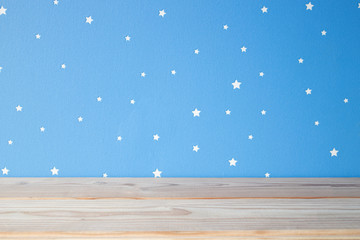 empty wooden table on the blue sky kids background