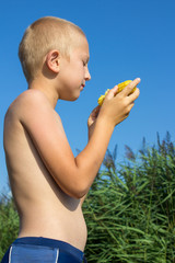 boy eats sweet corn