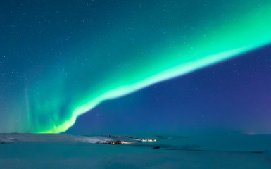 aurora borealis shining bright in the sky of winter iceland