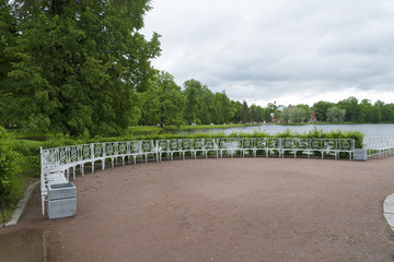 Summer Park with white benches and footpaths.