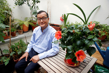 Former president of the dissolved opposition Cambodia National Rescue Party (CNRP) Sam Rainsy, who is living in exile, poses on his terrace in Paris