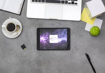 Tablet on a Messy Desk Mockup