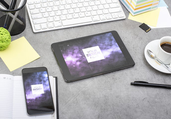 Smartphone and Tablet on a Messy Desk Mockup