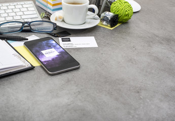 Smartphone on a Messy Desk Mockup