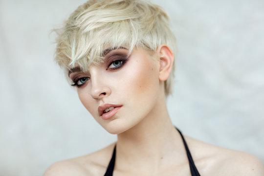 Beauty portrait of blond model in fashionable haircut