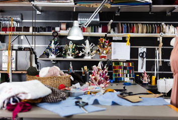 Image of workplace in sewing shop of variety clothes factory