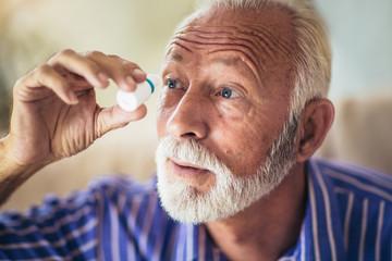 Elderly Person Using Eye Drops