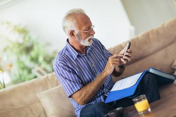 Senior man checking home finances.