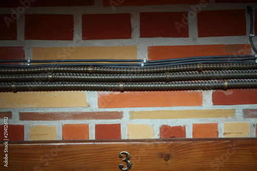Pleasing Electrical Wiring In A Metal Casing On The Wall Of A Brick Building Wiring 101 Orsalhahutechinfo