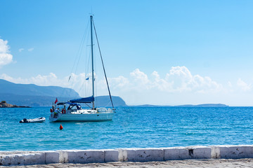 sailing boat leaving the harbour of Samos city