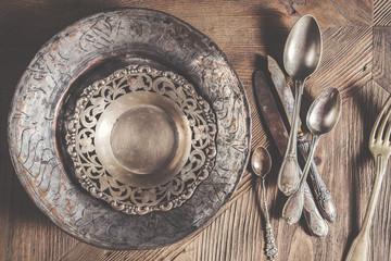 Vintage antique silverware on wooden background