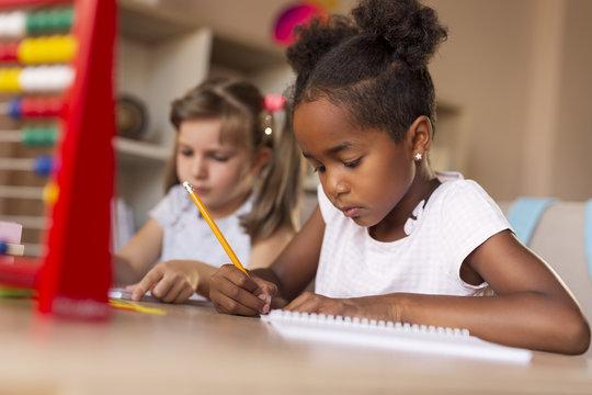 Little girls doing math homework