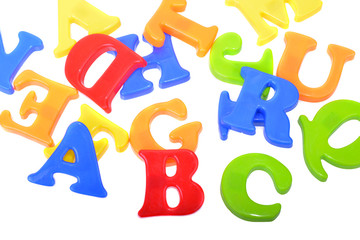 Close up of plastic letters showing ABC isolated on a white background