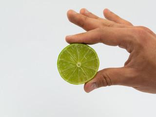 Handheld Lemon isolated in white background