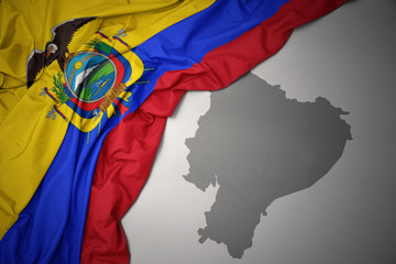 waving colorful national flag and map of ecuador.