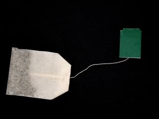 tea bag isolated on black background