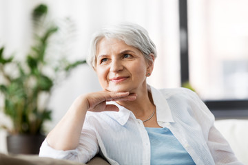 mature age and people concept - portrait of happy senior woman laughing