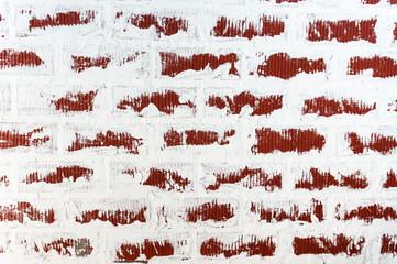 Background of brick wall texture with Damaged Plaster. Grunge Red Stonewall.