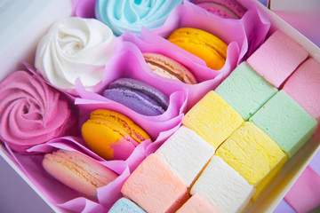 Multicolored set of different sweet marshmallow and macaroons in box