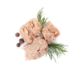 Delicious canned tuna chunks on white background, top view