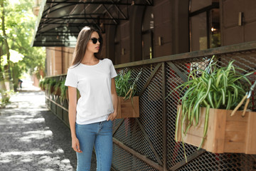 Young woman wearing white t-shirt on street
