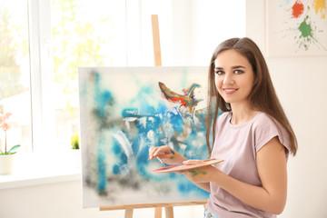Portrait of female artist in workshop