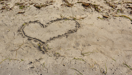 Heart painted on sand