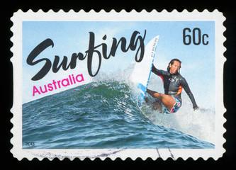 AUSTRALIA - CIRCA 2013: A stamp printed in Australia shows women surfing, circa 2013