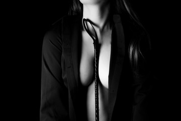 dominant woman with riding crop, bdsm. Beautiful woman tits and whip. Strict woman domination. Beautiful woman holding riding crop. Woman with bdsm toy. Sexy woman tits