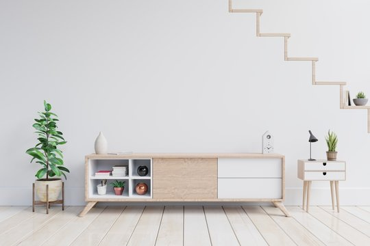 Tv shelf and put things together in modern empty room with plants on white wall background,3d rendering