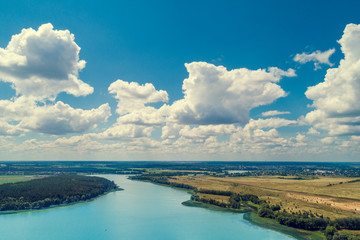 Aerial view of countryside and river. Blue sky with beautiful clouds