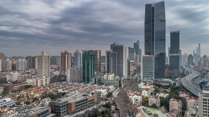 Aerial view of highway and buildings in West Yan`an road, Shanghai city on a cloudy day