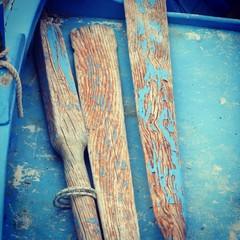 Peeling paint on boat and oars
